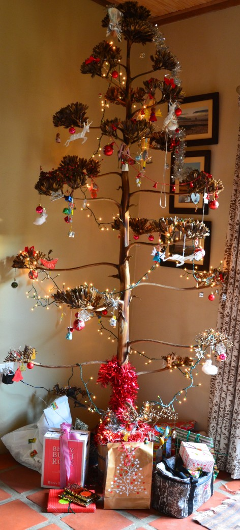 Presents under our African inspired sisal Christmas tree.