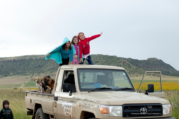 Kids on the back of the bakkie.