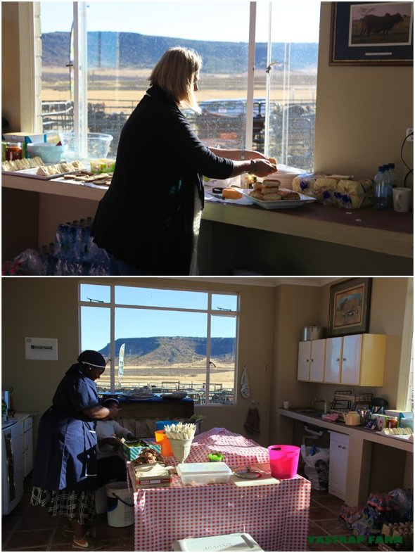 Karen and Matshepang making sandwiches on auction day.